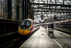A Virgin express passenger train arriving at Glasgow Central Station from London Euston<br /> <br /> (c) Andrew Wilson   Edinburgh Elite media
