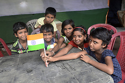 August 18, 2017 - Shibnibas, West Bengal, India - Children play with Indian national Flag during the celebration of Independence Day in Shibnibas, Nadia. People of Shibnibas, Nadia celebrate 71th Independence Day with zest and zeal in August 18, 2017 in Nadia.  Sir Radcliff draw the line of demarcation in Bengal and awarded Hindu majority Nadia to East Pakistan .Massive protests followed and Viceroy Lord Mountbatten ordered an immediate correction to the map. On the evening of 17 August All India Radio (AIR) announced that the majority of the district of Nadia to be part of India, for this reason Shibnibas a village of Nadia observes Independence Day on August 18. (Credit Image: © Saikat Paul/Pacific Press via ZUMA Wire)