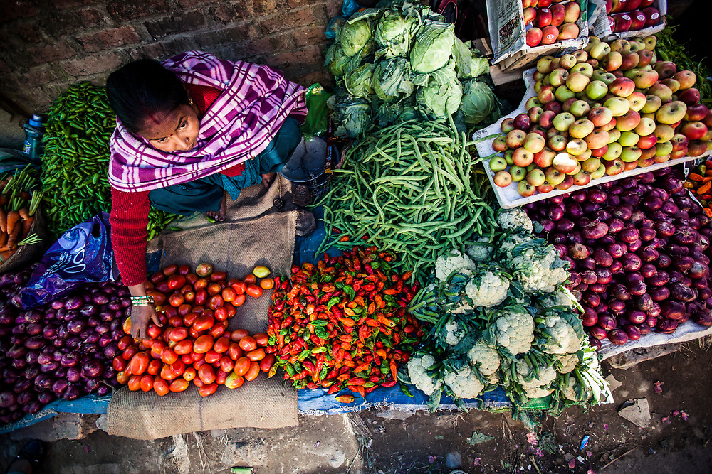 A market seller surrounded by Naga chilis and other produce at her stall in Kohima, the capital of Nagaland, India.