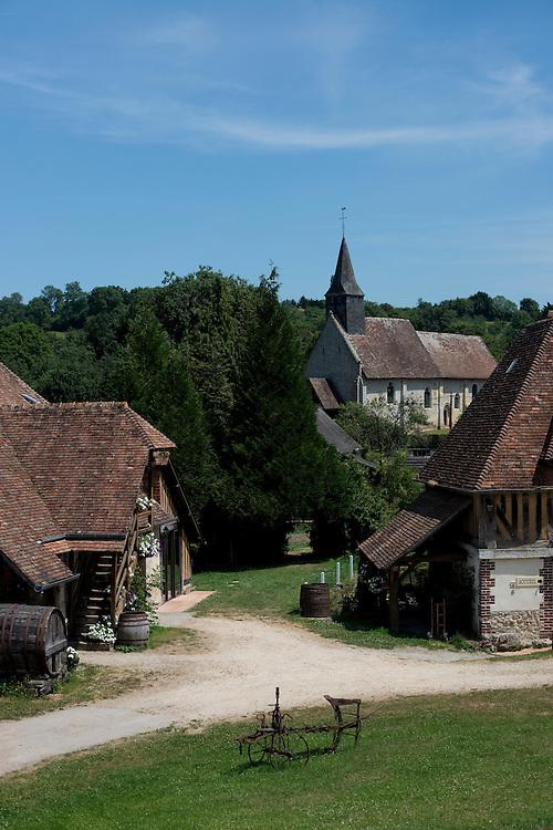 La ferme et l'&eacute;glise de Grandouet, typique du Pays d'Auge.<br /> Cambremer, France. 19/07/2013
