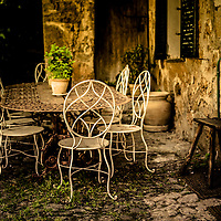 Decorative table and chairs on patio in France
