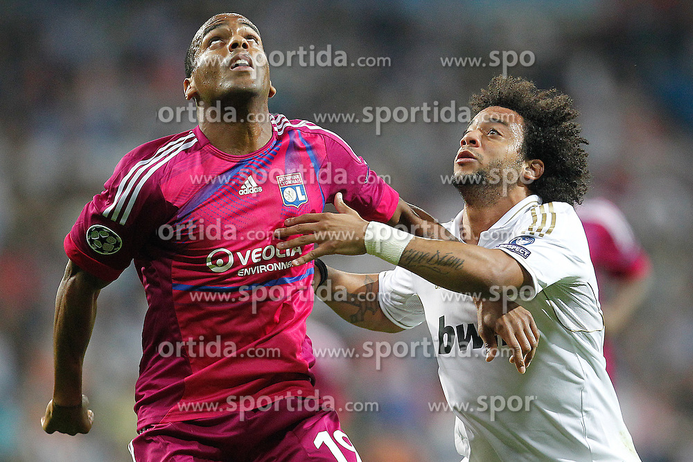 18.10.2011, Santiago Bernabeu Stadion, Madrid, ESP, UEFA CL, Gruppe D, Real Madrid (ESP) vs Olympique Lyon (FRA), im Bild Real Madrid's Marcelo and Olympique Lyonaise' Jimmy Briand // during UEFA Champions League group D match between Real Madrid (ESP) and Olympique Lyon (FRA) at City of Santiago Bernabeu Stadium, Madrid, Spain on 18/10/2011. EXPA Pictures © 2011, PhotoCredit: EXPA/ Alterphoto/ Cesar Cebolla +++++ ATTENTION - OUT OF SPAIN/(ESP) +++++