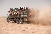Truck full of African migrants in the Ténéré desert going to Dirkou near the Libyan border.