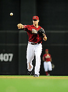 Apr. 17 2011; Phoenix, AZ, USA; Arizona Diamondbacks second basemen Kelly Johnson (2) throws the ball to first base for the out against the San Francisco Giants at Chase Field. The Diamondbacks defeated the Giants 6-5 in extra innings. Mandatory Credit: Jennifer Stewart-US PRESSWIRE.