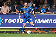 AFC Wimbledon defender Callum Kennedy (23) dribbling during the EFL Sky Bet League 1 match between AFC Wimbledon and Oldham Athletic at the Cherry Red Records Stadium, Kingston, England on 21 April 2018. Picture by Matthew Redman.