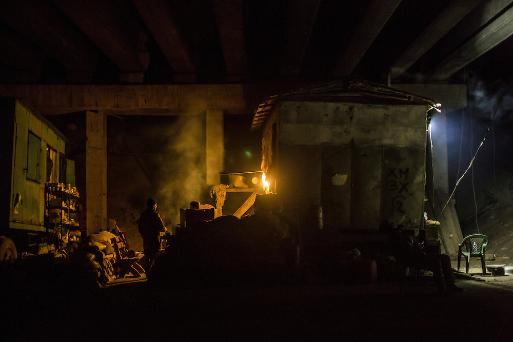 PERVOMAISKE, UKRAINE - MARCH 19, 2015: Members of the pro-Ukrainian Dnipro-1 battalion at one of the group's bases known as The Bridge near ongoing battles for the town of Pisky in Pervomaiske, Ukraine. CREDIT: Brendan Hoffman for The New York Times