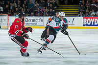 KELOWNA, CANADA - APRIL 8: Alex Overhardt #17 of the Portland Winterhawks checks Nick Merkley #10 of the Kelowna Rockets as he skates with the puck on April 8, 2017 at Prospera Place in Kelowna, British Columbia, Canada.  (Photo by Marissa Baecker/Shoot the Breeze)  *** Local Caption ***