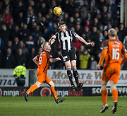 10th April 2018, Tannadice Park, Dundee, Scotland; Scottish Championship football, Dundee United versus St Mirren; Gary MacKenzie of St Mirren heads clear from Thomas Mikkelsen of Dundee United