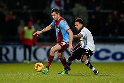 Tom Hopper of Scunthorpe United is challenged by Korey Smith of Bristol City - Photo mandatory by-line: Rogan Thomson/JMP - 07966 386802 - 17/01/2015 - SPORT - FOOTBALL - Scunthorpe, England - Glanford Park - Scunthorpe United v Bristol City - Sky Bet League 1.