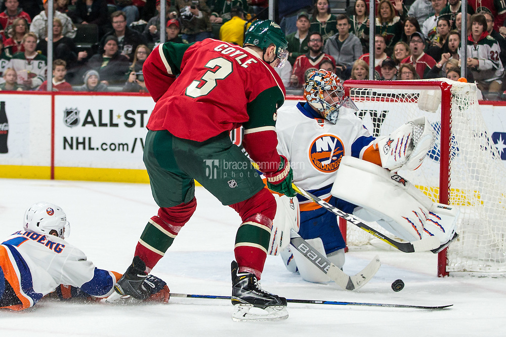 Dec 29, 2016; Saint Paul, MN, USA; New York Islanders goalie Jaroslav Halak (41) makes a save as defenseman Dennis Seidenberg (4) pokes the puck away from Minnesota Wild forward Charlie Coyle (3) during the second period at Xcel Energy Center. Mandatory Credit: Brace Hemmelgarn-USA TODAY Sports