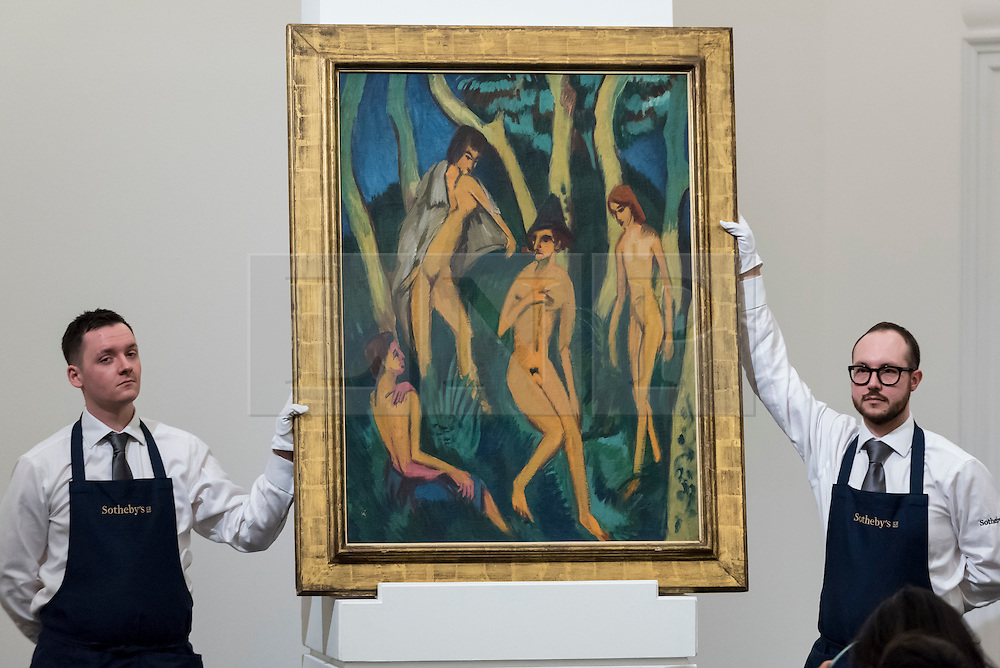 "© Licensed to London News Pictures. 01/03/2017. London, UK. Technicians show ""Vier Akte Unter Bäumen (Four Nudes Under Trees)"" by Ernst Ludwig Kirchner which sold for a hammer price of GBP4.7m (est. GBP3.5-5m), at the evening sale of Impressionist and Surrealist Art at Sotheby's in New Bond Street. Photo credit : Stephen Chung/LNP"
