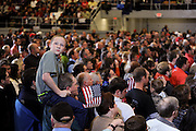 "Ten year old Devon Ellington sits atop the shoulders of his father, Eric Ellington during the ""Victory Rally"" for presidential candidate Mitt Romney in Marion, Ohio, Oct. 28, 2012"