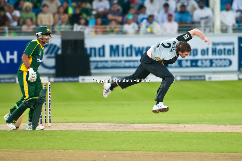 Dubai, UAE.  Ian Butler bowls out Kamran Akmal during the 2nd T20 (Twenty20) match between Pakistan and New Zealand held at Dubai International Cricket Stadium on the 13th November, 2009.  Photo by: Stephen Hindley/SPORTDXB/PHOTOSPORT