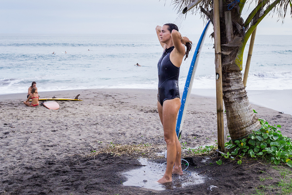 A woman is seen showering at Batubolong beach in Canggu.