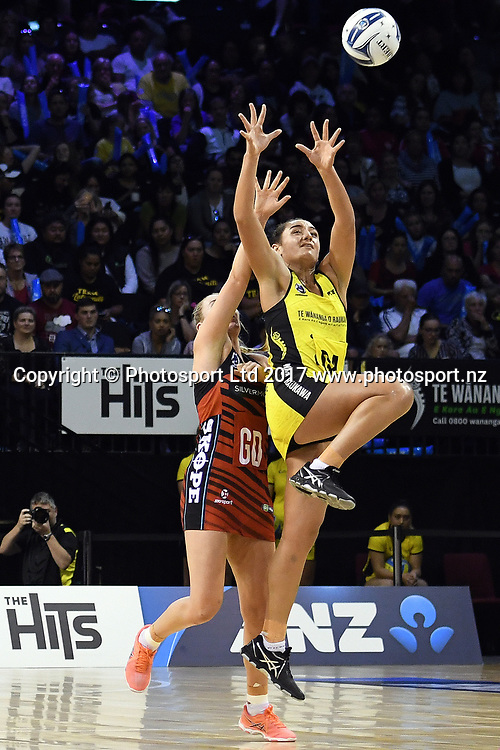 Central Pulse's Tiana Metuarau jumps high to grab the ball during the ANZ Premiership Netball match between Central Pulse v Mainland Tactix, TSB Arena, Sunday 09th April 2017. Copyright Photo: Raghavan Venugopal / www.photosport.nz
