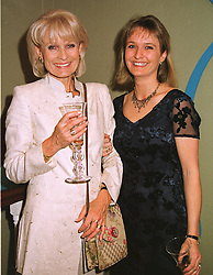Left to right, interior designer PRUE LANE FOX and her daughter MISS CHARLOTTE LANE FOX,  at a reception in London on 11th May 1999.MRX 51