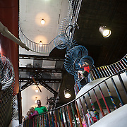 Saint Louis's City Museum is a giant 600,000 square foot playground old home to the International Shoe Factory. The museum includes a school bus hanging over the edge of the roof, cranes, old bridges, a human-sized hamster wheel, vintage opera posters, a room of preserved insects, a bank vault, plenty of labyrinths with a series of tunnels underneath the building, a giant indoor treehouse, and a slide that goes into the museum's pump room.<br /> Photography by Jose More
