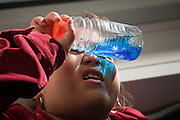 28 DECEMBER 2008 -- PHOENIX, AZ: A child looks through a partly empty water bottle while she rides the Metro train in central Phoenix, AZ. The new Metro Light Rail is 20 miles long and cost $1.4 billion dollars. Construction was funded by local, state and federal monies. The trains will operate on one line through Phoenix and the suburban communities of Tempe and Mesa. The trains started running Saturday, Dec 27, 2008 and will be free until Jan. 1, 2009. The regular fare will be $1.25 for one ride or $2.50 for an all day pass.  Photo by Jack Kurtz / ZUMA Press