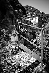 Capodigiano, Basilicata, Italy - The Ghost Dam. La diga di Muro Lucano. L'invaso nasce nell&rsquo;ambito di un pi&ugrave; ampio progetto di politica energetica, messo su da Francesco Saverio Nitti all'inizio del secolo scorso. Tra gli anni 1911 e 1914, volle realizzare la struttura idroelettrica di Muro Lucano e questa ebbe il primo tassello con la costituzione nel 1914 della Societ&agrave; Lucana per le imprese idroelettriche.&nbsp;La diga fu quindi il primo bacino idroelettrico costruito nell&rsquo;Italia Meridionale ed una delle prime opere in cemento armato in Italia. <br /> La storia della struttura, per&ograve;, non fu facile, sia sul fronte dell&rsquo;edificazione dell&rsquo;impianto sia su quello della strategia energetica degli anni 60-70, tanto che l&rsquo;impianto fu utilizzato a regime ridotto fino al 23 novembre 1980 anche se la Centrale fu dismessa negli anni '70. Da allora l&rsquo;impianto &egrave; rimasto inutilizzato, fermo e lasciato l&igrave; senza intervento di sistemazione.