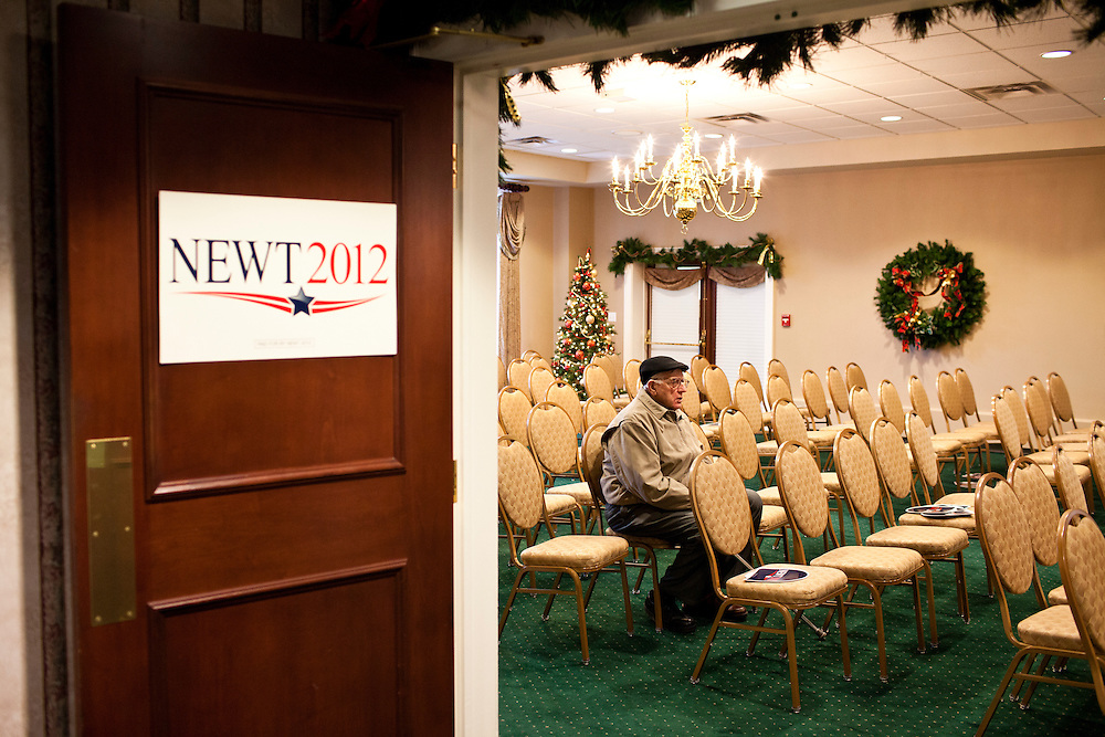 A man sits after hearing Republican presidential candidate Newt Gingrich speak at a Rotary Club meeting on Tuesday, December 27, 2011 in Dubuque, IA.