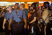 Captain Ronald Johnson of the Missouri State Highway Patrol walks and talks with the protesters in an attempt to de-escalate the tensions following the riots and protests after the killing of Michael Brown.
