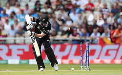 New Zealand's Colin Munro is bowled by West Indies Sheldon Cottrell during the ICC Cricket World Cup group stage match at Old Trafford, Manchester.