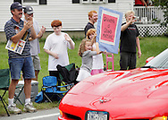 Salisbury Mills, New York - People lining Route 94 greet grand marshall Joseph Kennedyof the Salisbury Mills Fire Company during the Orange County Volunteer Firemen's Association (OCVFA) annual parade on Sept. 24, 2011.