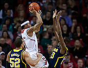 January 9, 2014: Deverell Biggs (1) of the Nebraska Cornhuskers shoots a jumper against Caris LeVert (23) of the Michigan Wolverines at the Pinnacle Bank Arena, Lincoln, NE. Michigan defeated Nebraska 71 to 70.