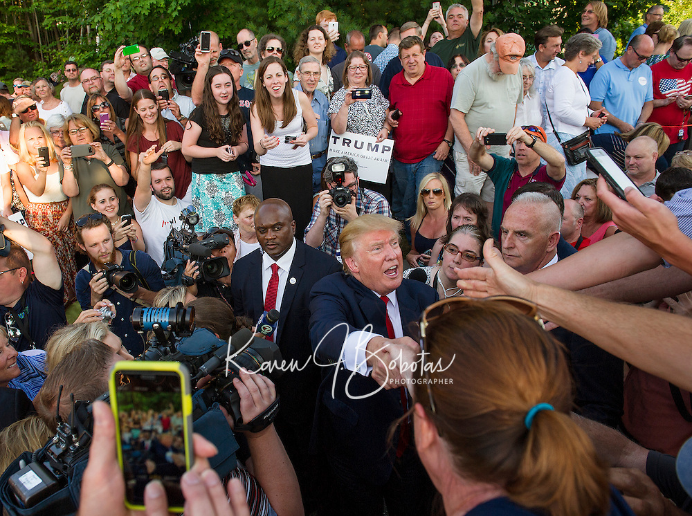 Republican Presidental candidate Donald Trump shakes hands with a large overflow crowd outside of the Weirs Beach Community Center on Thursday evening.  (Karen Bobotas/for the Laconia Daily Sun)