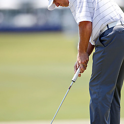 Apr 26, 2012; Avondale, LA, USA; John Rollins putts on the 18th hole during the first round of the Zurich Classic of New Orleans at TPC Louisiana. Mandatory Credit: Derick E. Hingle-US PRESSWIRE