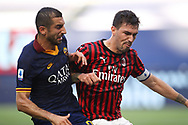 AS Roma's Armenian midfielder Henrikh Mkhitaryan battles shoulder to shoulder with AC Milan's Italian defender Alessio Romagnoli during the Serie A match at Giuseppe Meazza, Milan. Picture date: 28th June 2020. Picture credit should read: Jonathan Moscrop/Sportimage