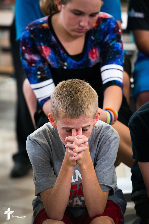 Students pray following an Owen's Mission presentation at Trinity Lutheran School on Monday, August 31, 2015, in Bloomington, Ill. LCMS Communications/Erik M. Lunsford