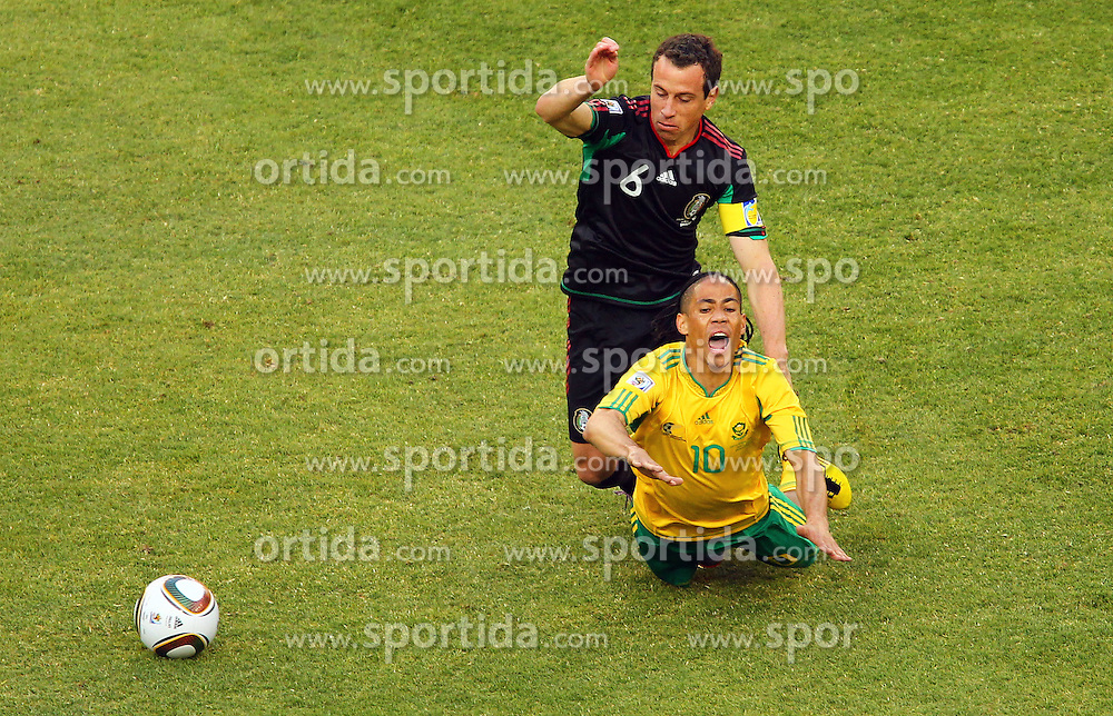 Mexico's Gerardo Torrado  vs South Africa's Steven Pienaar during the Group A first round 2010 FIFA World Cup South Africa match between South Africa and Mexico at Soccer City Stadium on June 11, 2010 in Johannesburg, South Africa.  (Photo by Vid Ponikvar / Sportida)