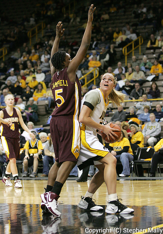 25 JANUARY 2007: Iowa forward Krista VandeVenter (51) looks to the basket while being guarded by Minnesota guard Korinne Campbell (5) in Iowa's 80-78 overtime loss to Minnesota at Carver-Hawkeye Arena in Iowa City, Iowa on January 25, 2007.