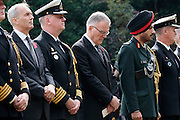 The British Ambassador in Tokyo, Tim Hitchens  (left) stands between military personnel and The Canadian Ambassador, Mackenzie Clugston, (centre) during the Remembrance Day ceremonies at the Commonwealth War Cemetery in Hodogaya, Yokohama, Japan. Wednesday November 11th 2015