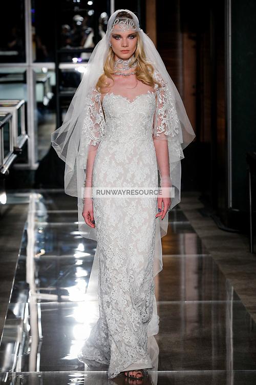 A model walks the runway wearing Reem Acra Bridal Spring 2018