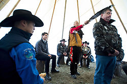 Prime Minister Justin Trudeau looks on as a chief receives a water cleansing by spiritual leader Cecil Grinder along with Chiefs of the Tsilhqot'in National Government near Chilko Lake, B.C.,Friday, Nov. 2, 2018. The Prime Minister was in the area to apologize to the Tsilhqot'in community for the hangings of six chiefs during the so-called Chilcotin War over 150 years ago. Photo by The Canadian Press /Jonathan Hayward/ABACAPRESS.COM