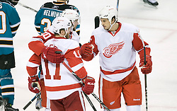 April 29, 2010; San Jose, CA, USA; Detroit Red Wings right wing Dan Cleary (11) is congratulated after scoring a goal during the first period in game one of the western conference semifinals of the 2010 Stanley Cup Playoffs against the San Jose Sharks at HP Pavilion. San Jose defeated Detroit 4-3. Mandatory Credit: Jason O. Watson / US PRESSWIRE