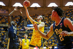 Dec 8, 2018; Morgantown, WV, USA; West Virginia Mountaineers guard Chase Harler (14) shoots in the lane during the second half against the Pittsburgh Panthers at WVU Coliseum. Mandatory Credit: Ben Queen-USA TODAY Sports