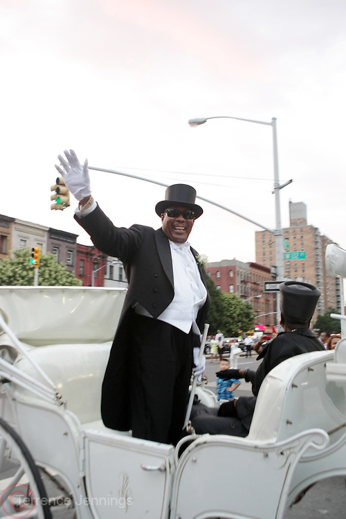 July 24, 2012-New York, NY:  Rev. Isaiah Owens, Funeral Director, Isaiah Owens Funeral Home attends the official Slyvia Woods Harlem Community memorial and send off through the streets of Harlem. Sylvia Woods was an American restaurateur who co-founded the landmark restaurant Sylvia's in Harlem on Lenox Avenue, New York City with her husband, Herbert Woods, in 1962. (Photo by Terrence Jennings)