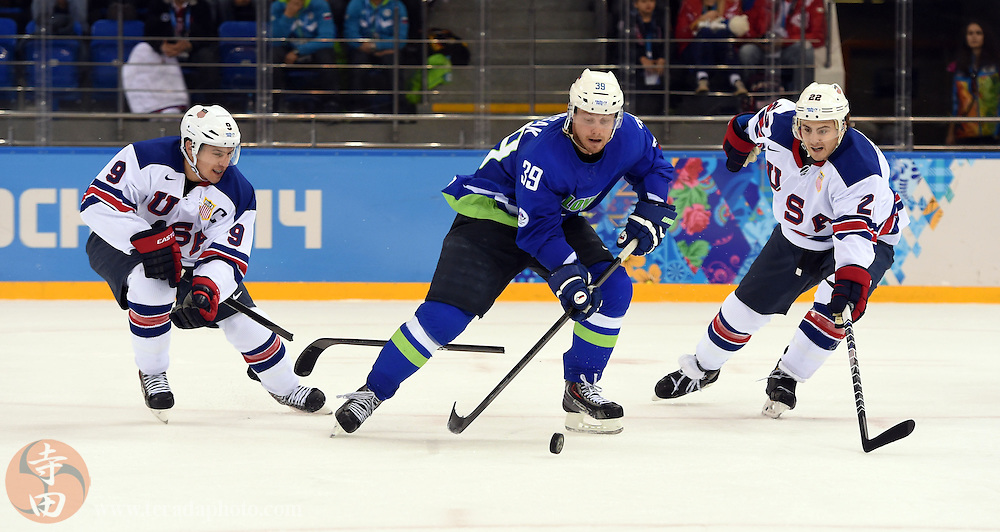 Feb 16, 2014; Sochi, RUSSIA; Slovenia forward Jan Mursak (39) skates between USA forward Zach Parise (9) and defenseman Kevin Shattenkirk (22) in a men's ice hockey preliminary round game during the Sochi 2014 Olympic Winter Games at Shayba Arena.