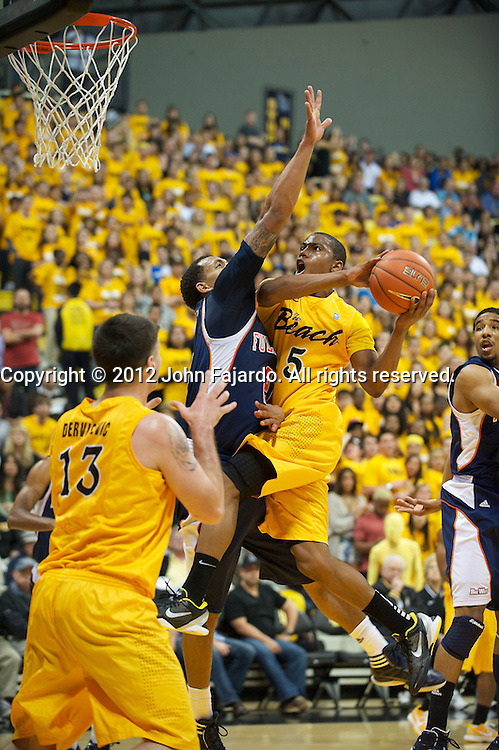 Mike Caffey drives in for the lay up in the Big West Conference match against Fullerton State at the Walter Pyramid, Long Beach, Calif., Sat., Jan. 28, 2012.