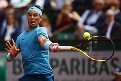 May 29, 2018 - Paris, Ile-de-France, France - Spain's Rafael Nadal plays a backhand return to Italy's Simone Bolelli during their men's singles first round match on day three of The Roland Garros 2018 French Open tennis tournament in Paris on May 29, 2018. (Credit Image: © Mehdi Taamallah/NurPhoto via ZUMA Press)