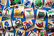 Art on a noticeboard in a UK nursery school classroom depicting aliens and monsters and fictitious characters.
