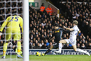 Picture by David Horn/Focus Images Ltd +44 7545 970036.28/11/2012.Michael Dawson (right) of Tottenham Hotspur cannot prevent a shot from Luis Suarez of Liverpool during the Barclays Premier League match at White Hart Lane, London.