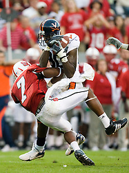 Virginia wide receiver Maurice Covington (80) brings in a pass despite the attempts of North Carolina State safety DaJuan Morgan (7) to break it up.  The North Carolina State Wolfpack defeated the #15 Virginia Cavaliers 29-24 at Carter Finley Stadium in Raleigh, NC on October 27, 2007.