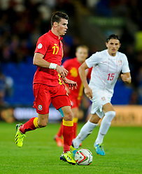 Gareth Bale of Wales (Real Madrid) is tracked by Ljubomir Fejsa of Serbia (Benfica) during the second half of the match - Photo mandatory by-line: Rogan Thomson/JMP - Tel: Mobile: 07966 386802 10/09/2013 - SPORT - FOOTBALL - Cardiff City Stadium - Cardiff -  Wales V Serbia- World Cup Qualifier.