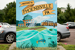 An illustration of a train rolling past the Foundry is found on a utility box at a parking lot along Bridge Street in Phoenixville, PA, on August 21, 2018.