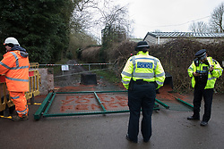 Harefield, UK. 14 January, 2020. A police officer observes a gate installed the previous day across a public right of way by enforcement agents working on behalf of HS2 which is believed to have been vandalised by Stop HS2 activists during the night. Stop HS2 activists are currently being evicted from a protection camp along the public footpath. 108 ancient woodlands are set to be destroyed by the high-speed rail link and further destruction of trees for HS2 in the Harvil Road area is believed to be imminent.