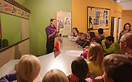 Grant Stevens, Development Director, talks with students from Westfield Elementary School at the lunch counter section of the Endless Possibilities exhibit at the African American Museum of Iowa in Cedar Rapids on Friday, March 22, 2013.